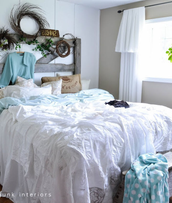 A gate and sawhorse meant for outdoors share a life together indoors these days. The bedding was created by throwing loose linens on top of a quilt. Sheets were tucked in between the mattresses for a full length look.   How to is at: http://www.funkyjunkinteriors.net/2012/05/how-to-decorate-bedroom-with-messy.html