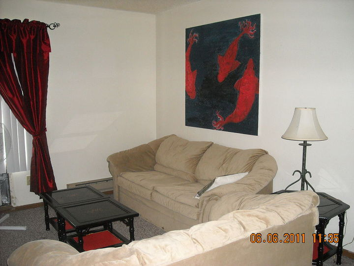 my humble living room before..I even did my own 4x4 paintings to brighten the place up.