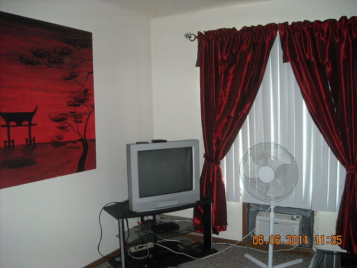 another shot of the before living room with another of my paintings.