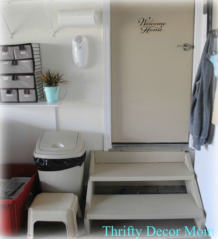 "A faux plant and ""welcome"" vinyl on the door make this seem like a real mudroom!"