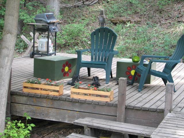 Some old loud speakers make wonderful side tables on deck.