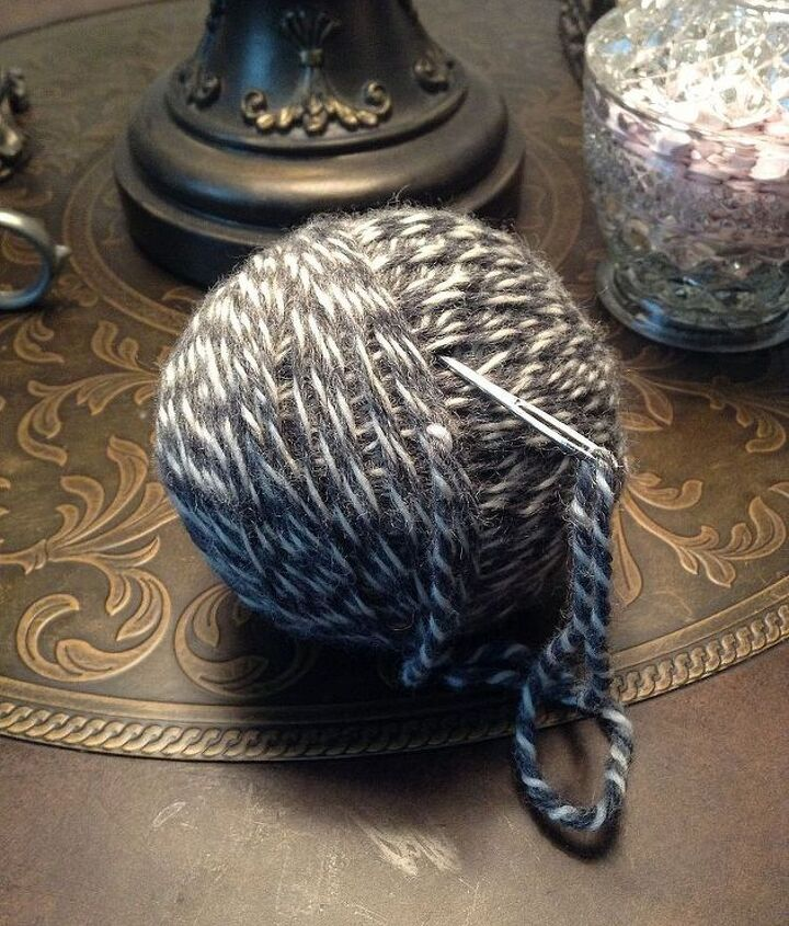 When you come to about the last 5 inches of yarn, thread it though your large yarn needle.Once threaded push the needle through the ball and pull it out the other end.