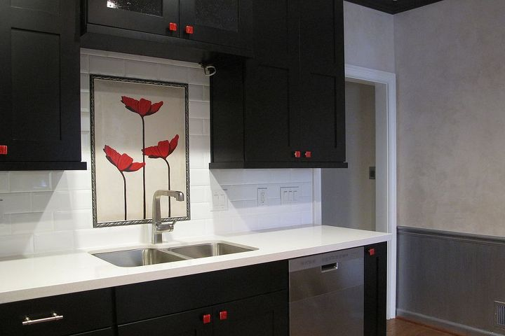 Hand painted tile on back splash to blend with walls.