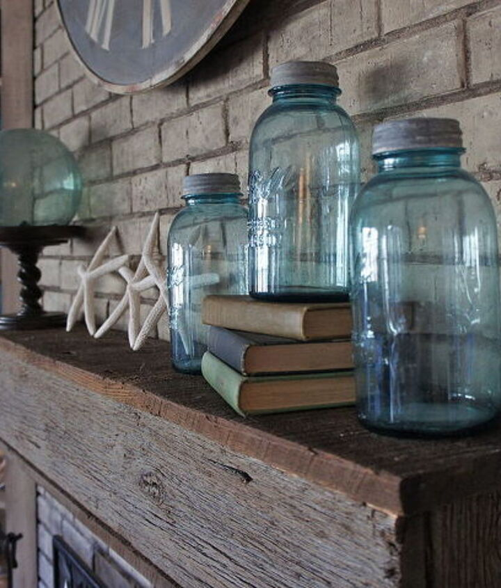 Repurposed accessories and a barn wood mantle.