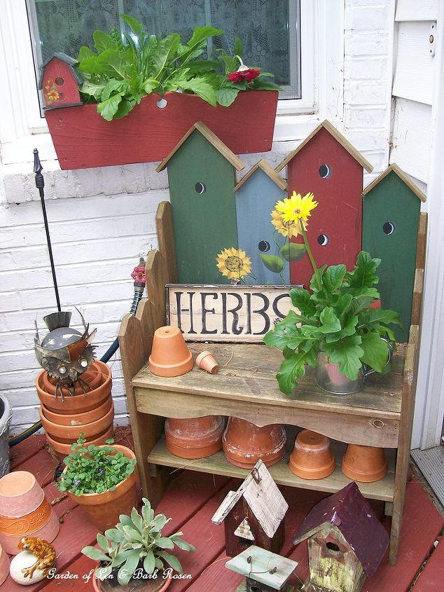 This sweet little bench, the window box and all the clay pots were garage sale finds that now pretty up our kitchen door entrance. See more at http://ourfairfieldhomeandgarden.com/ http://pinterest.com/barbrosen/our-fairfield-garden/