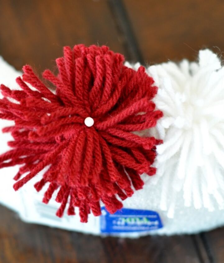 Using corsage pins with a head, attach the pom-poms to a styrofoam wreath.