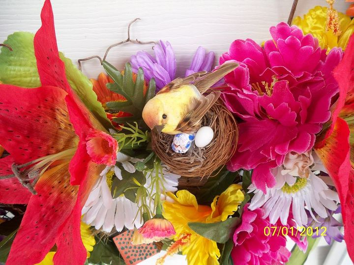 MOMMA BIRD incubating her eggs. Wait!  What is that funny looking one?  (Well, my granddaughter made that one - 'nuff said)