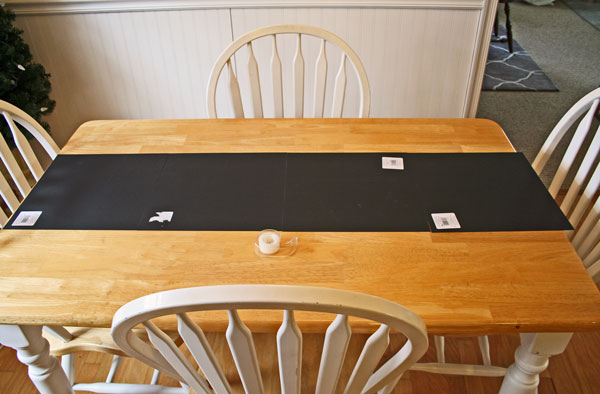 1. I decided to use four sheets of chalkboard scrapbook paper (yes they have this – isn't that awesome!?). I laid them out on the table to the length I wanted and then just taped them together on the backside.