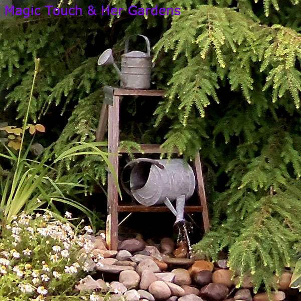 "A fountain provides ""natural"" music http://magictouchandhergardens.wordpress.com/2013/08/19/mini-woodland-garden/"