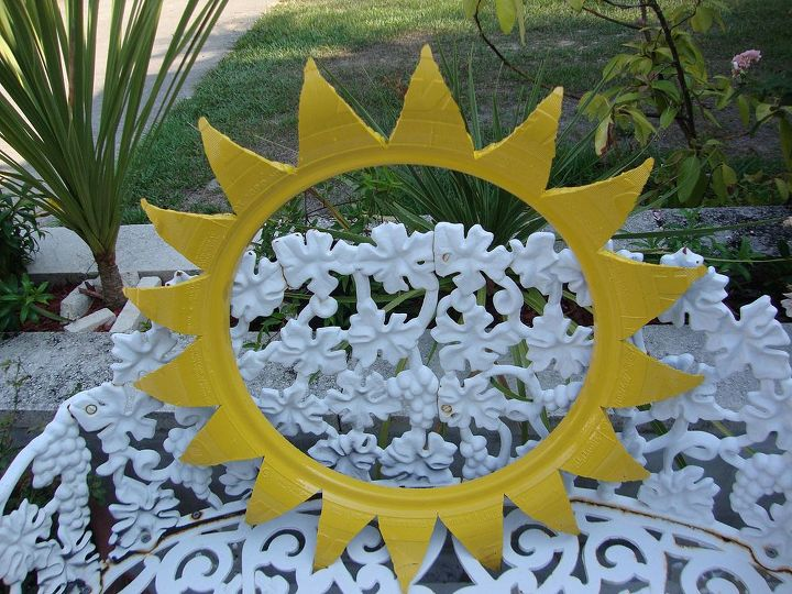 new craze old planters as miriam i has posted earlier before, gardening, repurposing upcycling, The cutout from the tire to give the planter its ending petal shape This cutout could be used as a wall decoration or what have you