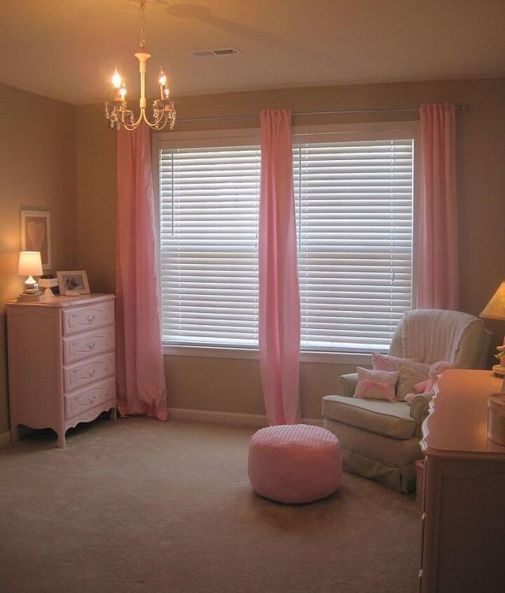 Refinished furniture & homemade accessories personalize my baby's nursery.