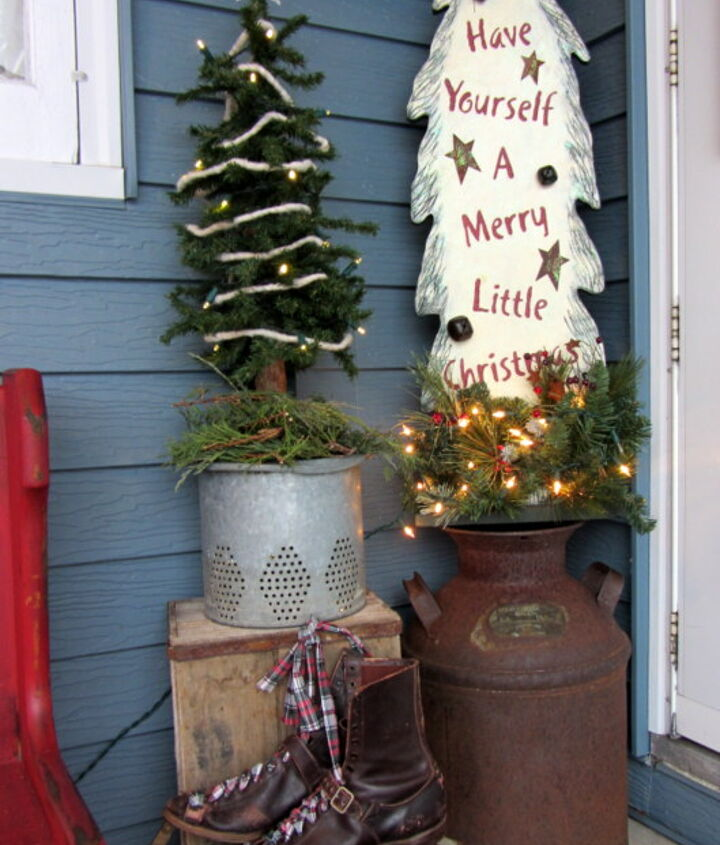 I also added an alpine tree on a vintage minnow bucket insert.  (I plant flowers in it in the summertime).  Another wooden lighted tree, milk can, crate and Victorian ice skates round out the front patio vignette.