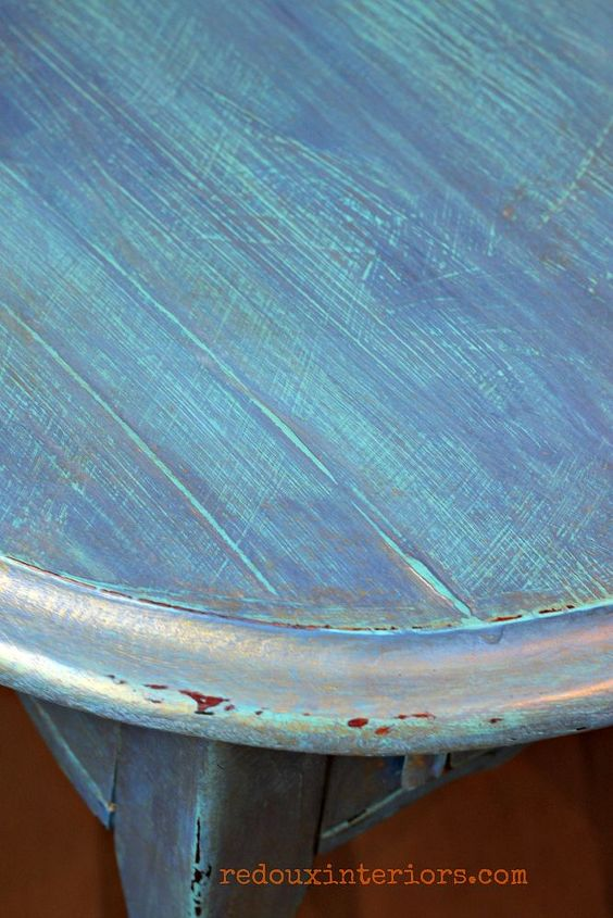 I painted the first coat of CeCe Caldwells Santa Fe Turquoise in a cross hatch method. The next layer was a thin wash of Maine Harbor Blue. The cross hatch method brings texture to the piece and really makes the wash pop.