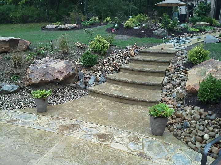 steps from the pool to the main patio and water garden