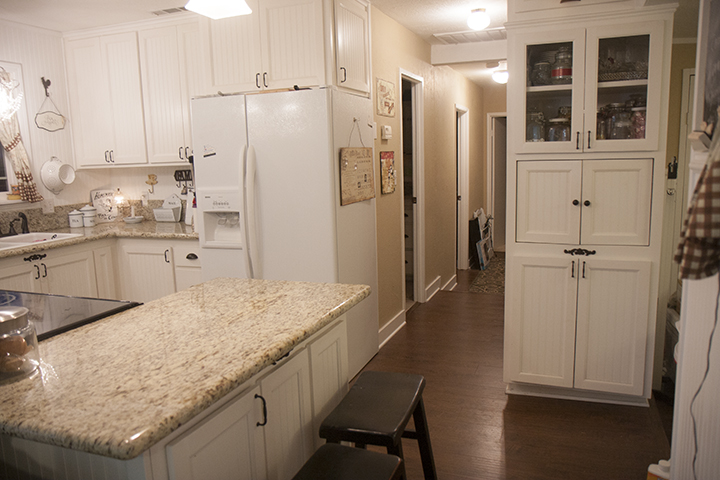 This shows the one door below the bar that is accessible and kind of the length of the bar and to the right is the microwave cabinet I had made to look like a built in