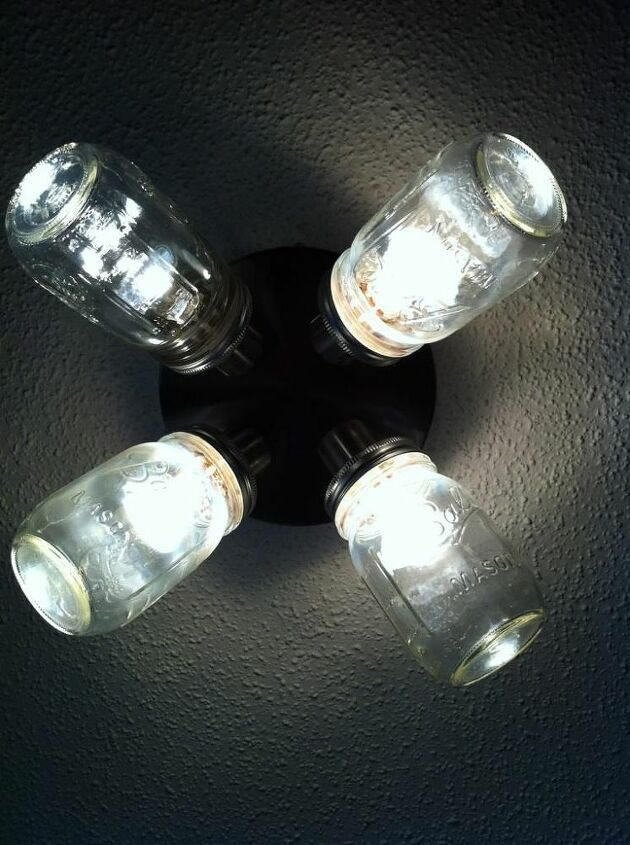 here are some more home made ball mason jar lights, crafts, lighting, mason jars, My son Lance glued the lids to the light and drilled holes for the bulbs he turned an ugly light into a fun one