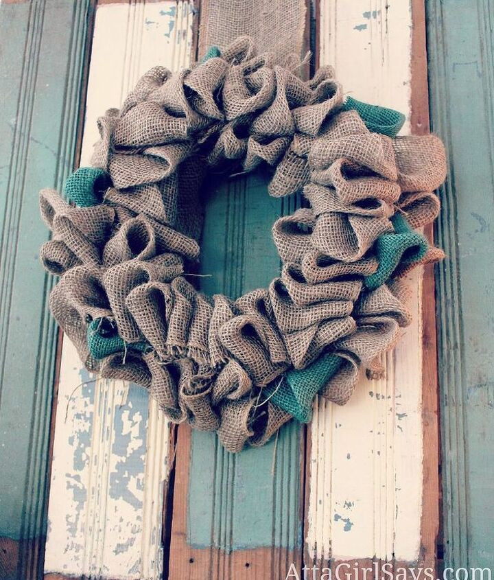 Burlap wreath on chippy blue and cream vintage salvaged wainscoting