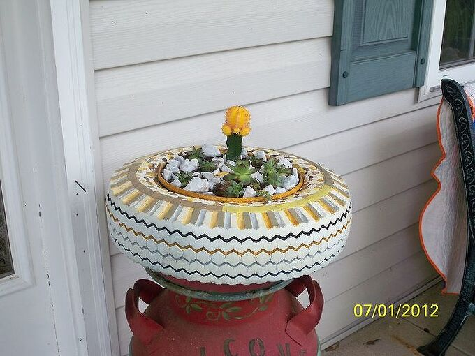 the leopart tire planter, gardening, repurposing upcycling, But then I decided the front porch would be better if I didn t want to roast it so it ended up on an old milkcan