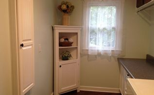 laundry room update, home decor, laundry rooms, Vintage curtains from my Mom turned on the side and clipped up The cabinet had been in our kitchen for years I just painted it The ironingboard cabinet on the left was given wallpaper and paint to match too