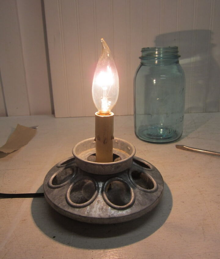 I put the candle lamp back together after screwing the column portion of it onto the chick feeder.