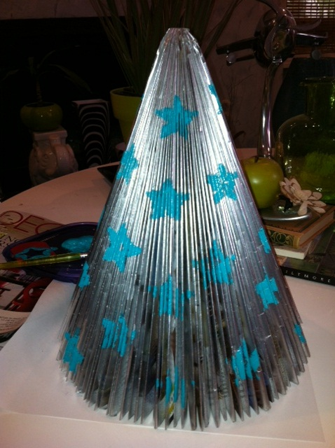 old magazines turned into christmas trees using simple origami, christmas decorations, crafts, seasonal holiday decor, This is what you will end up with with your own spin of colors decoration etc or just leave plain