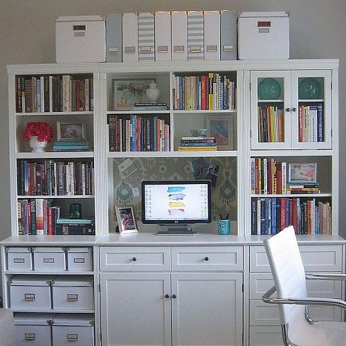 I decided to brighten the bookcases by painting them white.