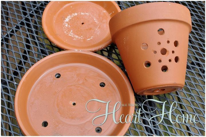 You have to drill several holes in the pots/saucers and to do this you'll need a drill with a masonry bit. After soaking your terra cotta and marking your holes, slowly drill over markings applying steady pressure as you drill.