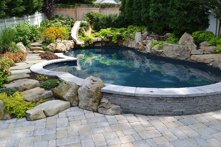 """Swimming pool """"Pulled up"""" out of the patio to create a seatwall so friends can sit right at the waters edge."""