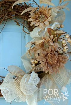 my new diy fall wreath, crafts, seasonal holiday decor, wreaths, I used a variety of burlap ribbon burlap sunflowers berries and grapevine to create visual interest without much color