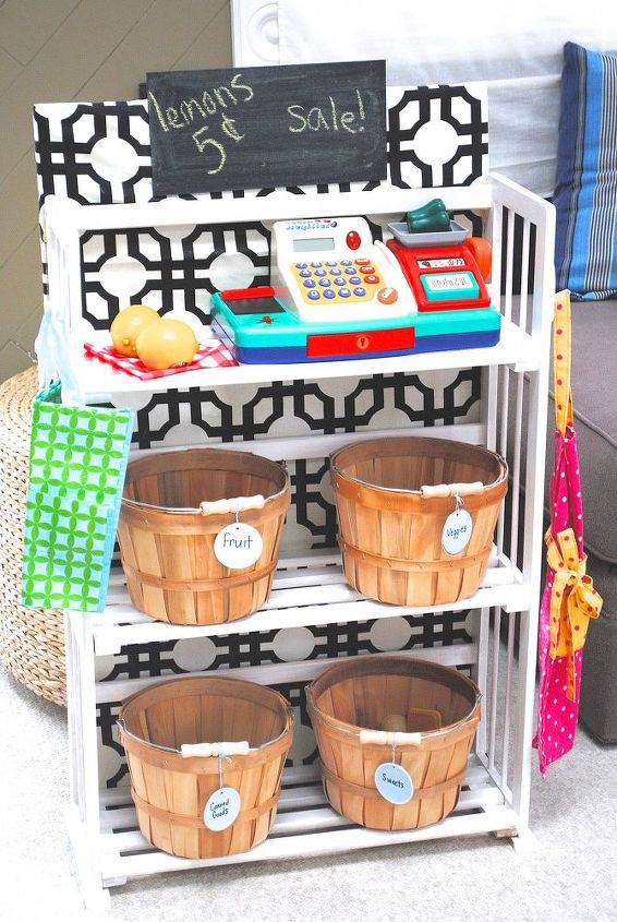 simple bookcase turned kids grocery store amp toy storage, diy, painted furniture, storage ideas, A sweet little pretend play grocery store with bushel baskets of food a cash register grocery bag and grocer s apron