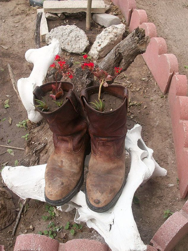 Used my husband's old working boots as planters.
