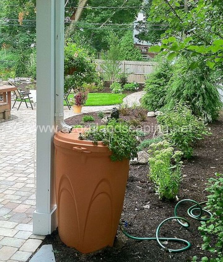 Landscape Design & Installation with Walkway, Patio, Rock Fountain, Pondless Waterfall, Rain Barrel and Landscape Lighting, Patio and Landscape Design Acorn Landscaping of Rochester NY installed in Penfield NY by Acorn Landscaping.