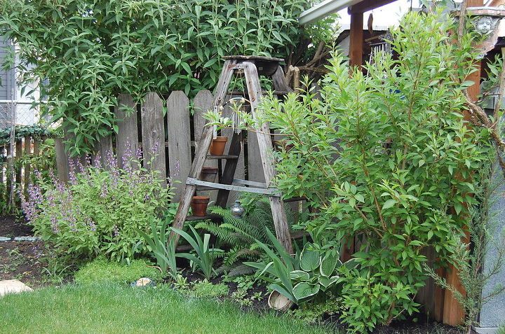 old ladder with wooden wheels