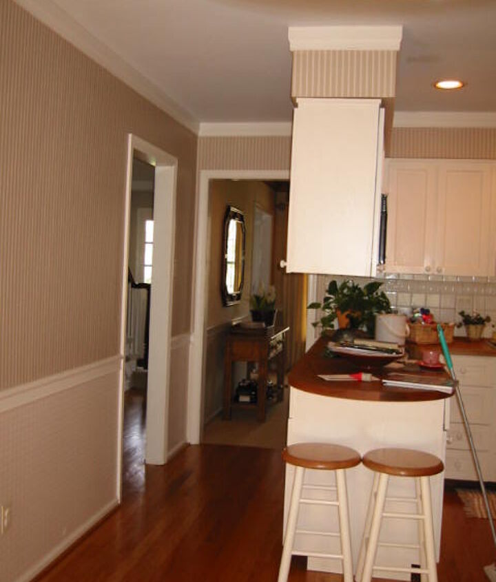 BEFORE: Existing dining room wall shown in background removed to open up the entire area.