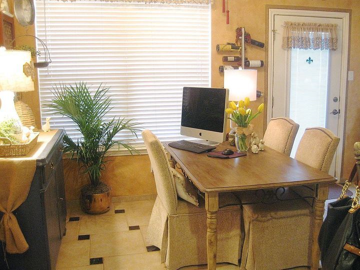 I moved my desk from my office to the kitchen and added the chairs that were around our card table.
