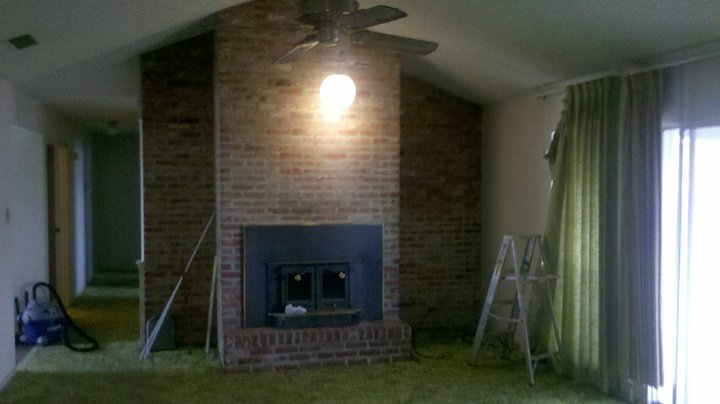 On the opposite end is the fireplace wall.