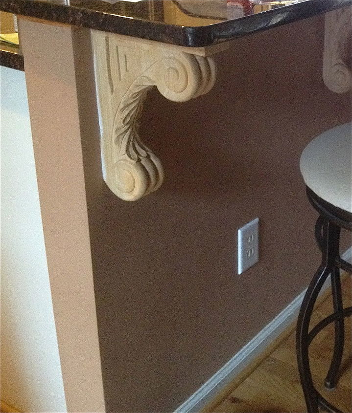 """Before"" of raw wood corbel for counter in kitchen."