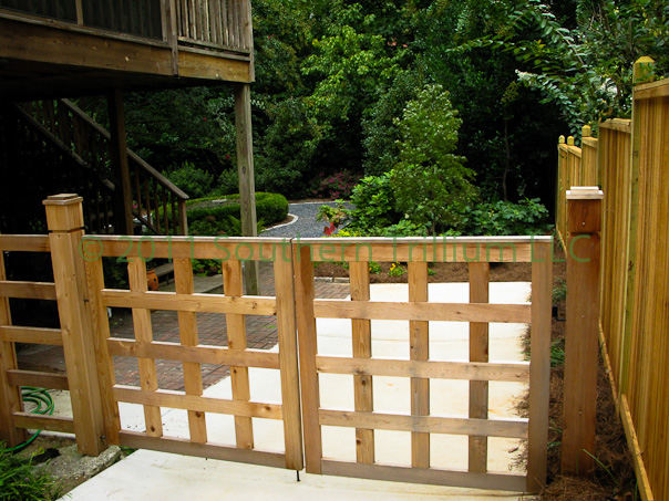 The custom Cedar gate we designed and built for our client providing entry into the backyard garden.