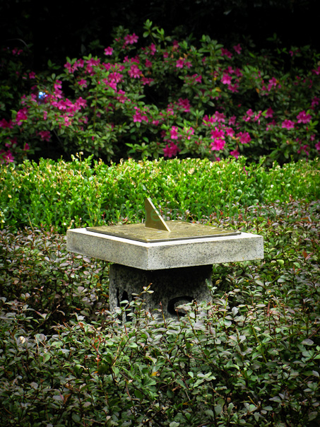 A detail view of the sundial in the garden, custom made for its location.