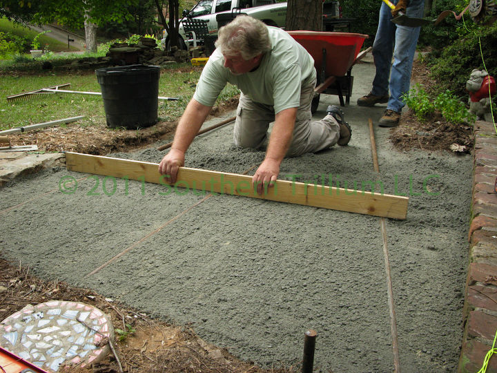 One person can screed the sand on a narrow walkway.