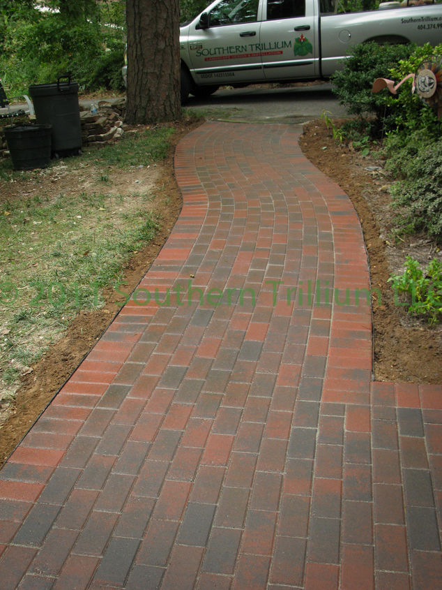 Finished walkway after installing pavers, compacting and wetting down the polymeric sand.