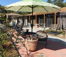 umbrella holder in a cement plant container, concrete masonry, diy, repurposing upcycling, nice shade under that chair