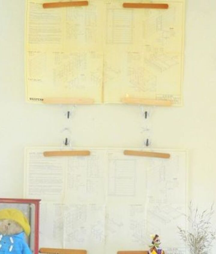 a simple way to hang your posters and pictures pant hangers, home decor