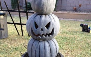 Painted cheap plastic pumpkins to look like stone