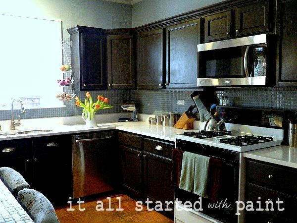 Kitchen remodel:  painting builder grade oak cabinets
