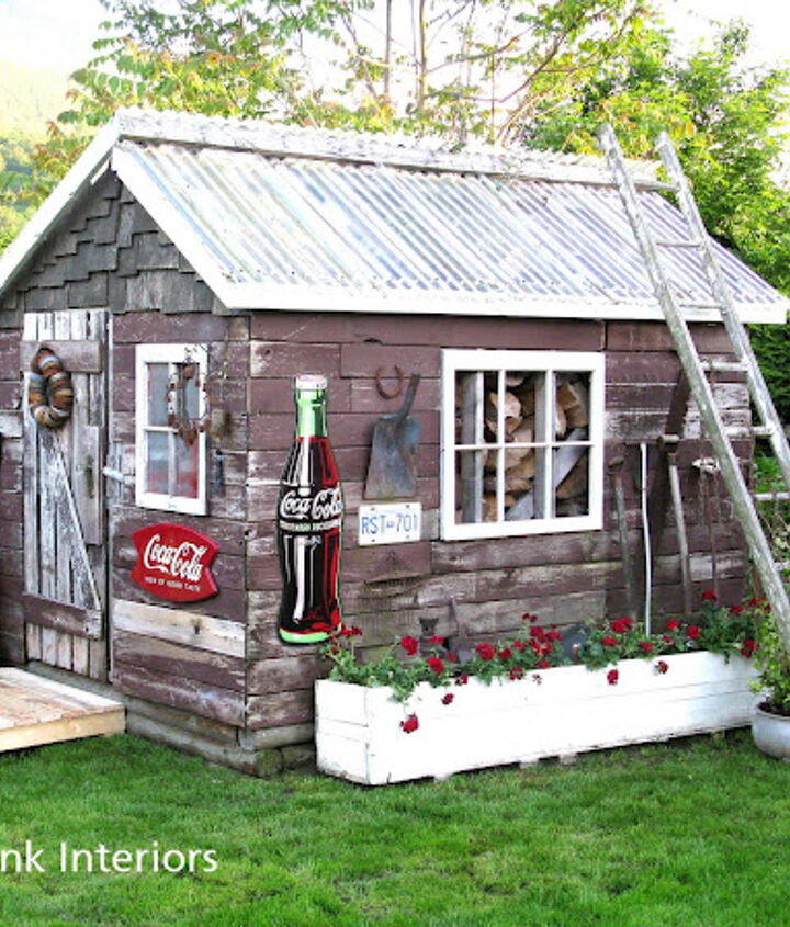 a rustic shed made from reclaimed lumber, doors, outdoor living, repurposing upcycling, All the rustic bling makes for a fun focal point in the backyard The white planter box use to be a firetruck parts crate A couple pallets offer a front step and side walkway A rusty old vintage headboard became a gate