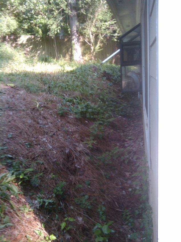 That's about 12 inches between the bottom of the slope and the foundation.  Plus, NO DRAINAGE!