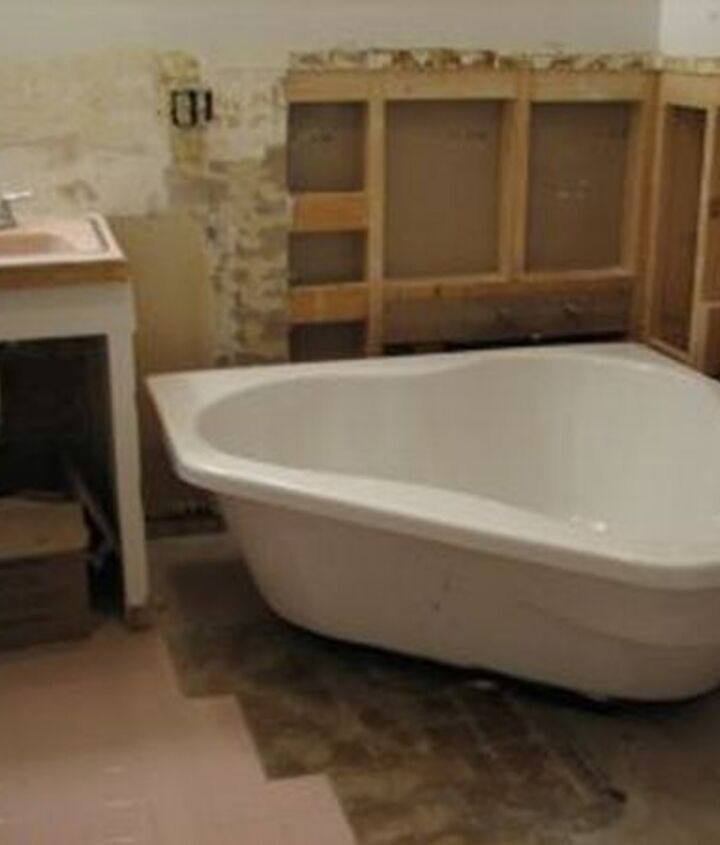 A soaking corner bath tub. The frame work was put in by a carpenter and the plumbing done by a professional plumber. (Not my metier)