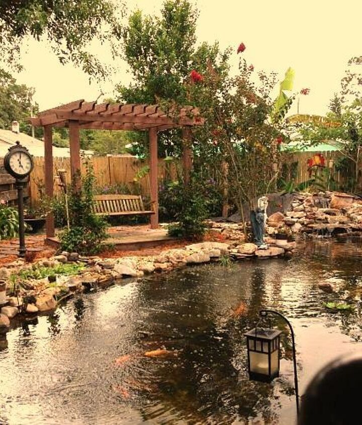 This is the clients view from the back door and the porch,the up bog waterfalls are on the left side of the pond along the path to the swing which is a great seating area in the late afternoon as the sun sets