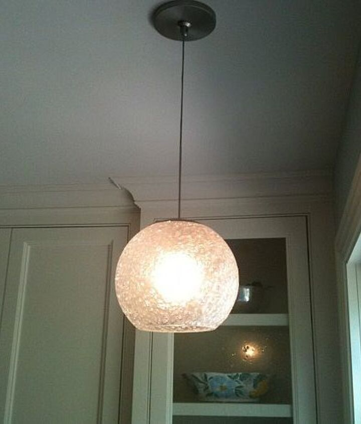 This fun pendant is over the sink! Great accent!